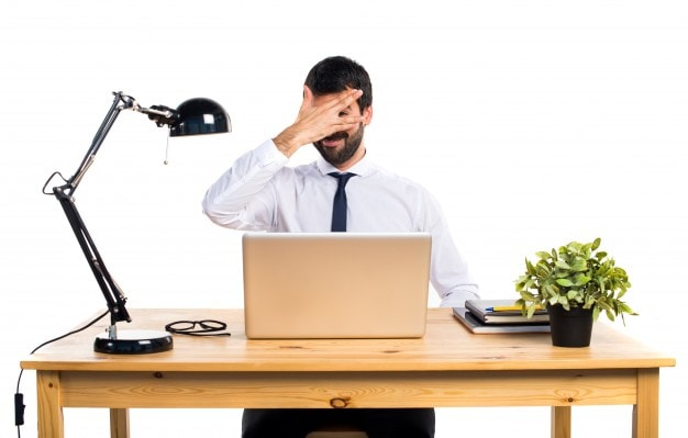 businessman-in-his-office-covering-his-face_1368-7266-min